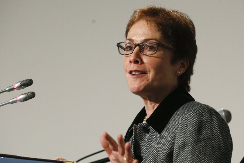FILE - In this Nov. 30, 2018, file photo, then-U.S. Ambassador to Ukraine, Marie L. Yovanovitch, speaks in Kyiv, Ukraine. Yovanovitch was removed from her post after insisting that a request to Ukrainian officials to investigate President Donald Trump's political rival be conveyed through official channels, according to a fellow former diplomat. (AP Photo/Efrem Lukatsky)