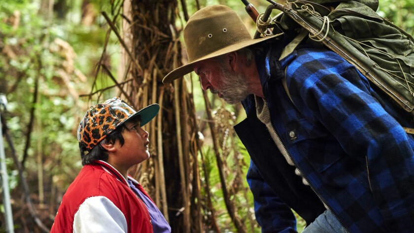 """Actors Julian Dennison, left, and Sam Neill are lost in the New Zealand bush in """"Hunt for the Wilderpeople."""""""