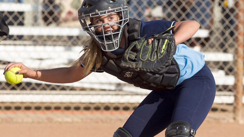 Marina's Ryan King looks to throw to first during a nonleague softball game against Mater Dei on March 27, 2014.