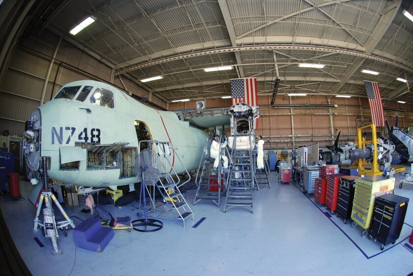 A C-2 Greyhound aircraft is under repair at Fleet Readiness Center Southwest in Building 460. The bribery ring that eventually ensnared 11 people was centered on this program and this building.