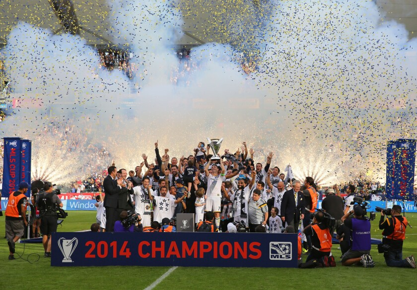 Galaxy forward Robbie Keane hoists the Philip F. Anschutz Trophy after the Galaxy won the 2014 MLS Cup in December.
