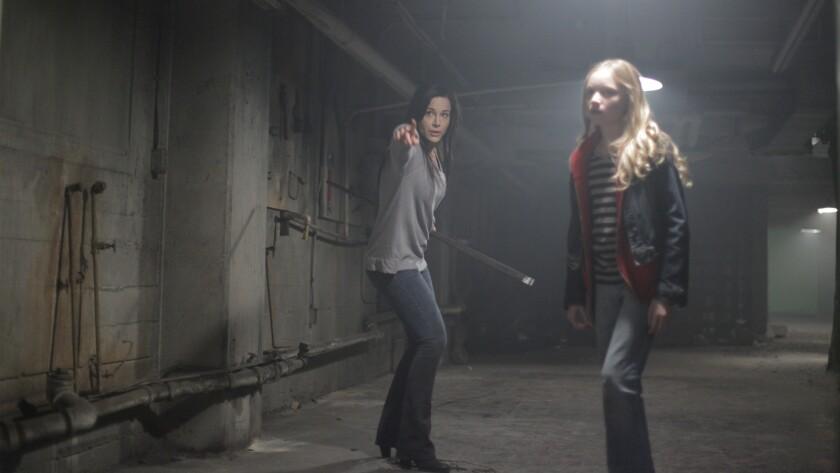 """Danielle Harris, left, and Belle Shouse in the film """"Havenhurst."""""""