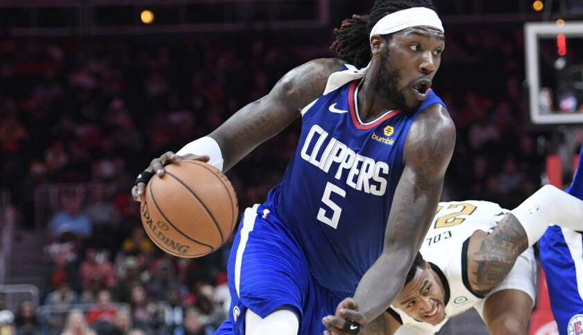 Clippers forward Montrezl Harrell drives against the Hawks during a game Monday in Atlanta.