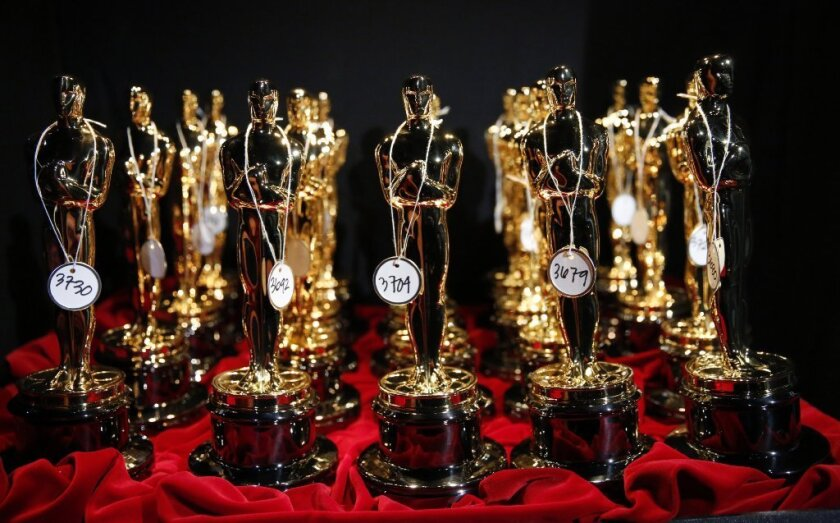 A group of Oscar statuettes.