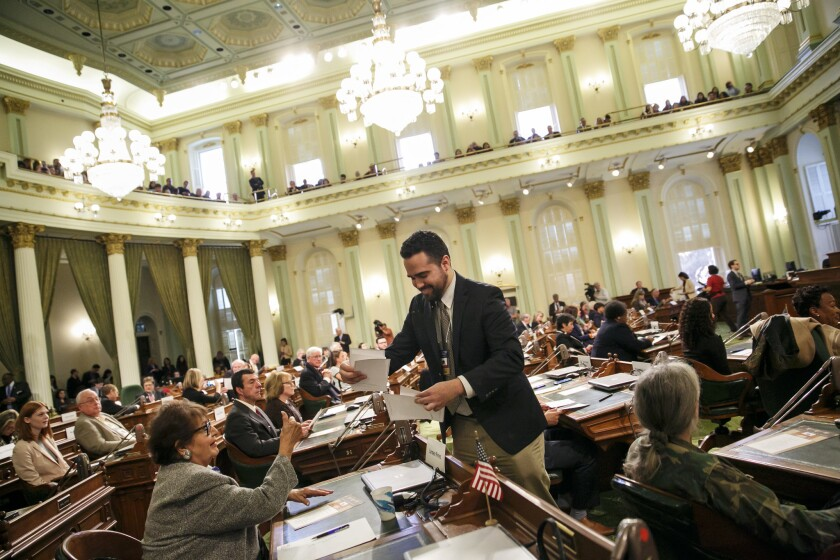 Andres Ramos collect the ballots voted by the members of the electoral college at the state Capitol in Sacramento.