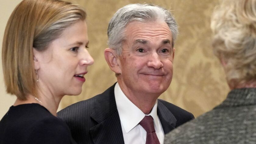 "Federal Reserve Chairman Jerome ""Jay"" Powell, center, could be a topic at your holiday meal. Get ready."