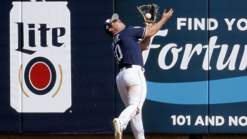 San Diego Padres' Hunter Renfroe takes a hit away from San Francisco Giants' Yangervis Solarte durin