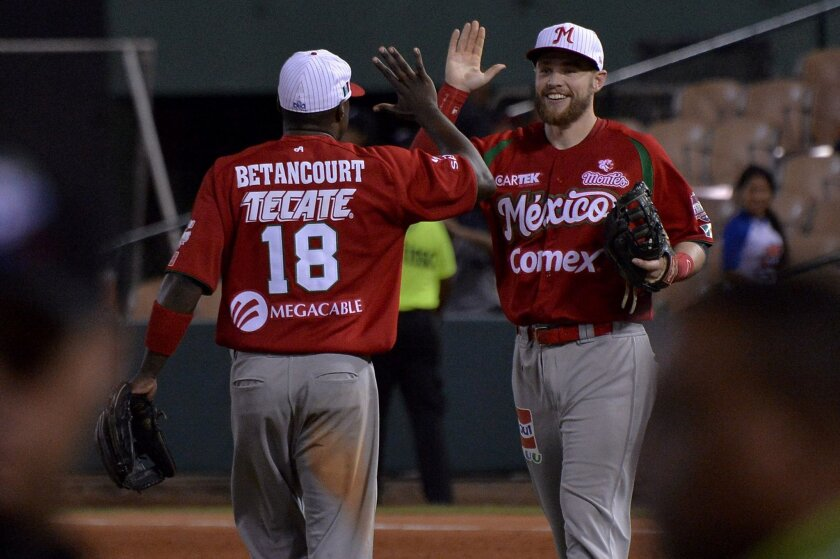 The players of Mexico celebrate after defeating Dominican Republic in their 2016 Caribbean baseball series game on February 1, 2016 in Santo Domingo. AFP PHOTO/YAMIL LAGE / AFP / YAMIL LAGEYAMIL LAGE/AFP/Getty Images ** OUTS - ELSENT, FPG, CM - OUTS * NM, PH, VA if sourced by CT, LA or MoD **