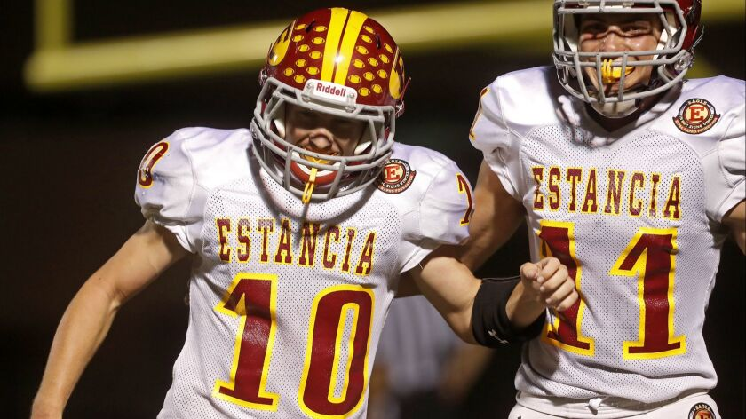 Estancia High running back Trevor Pacheco (10) and wide receiver Hayden Pearce (11) celebrate Pachec