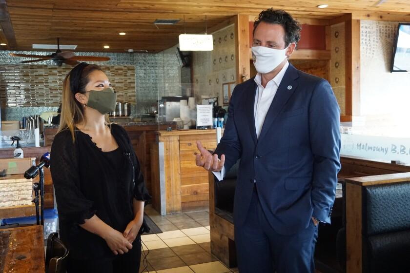 Grace Chi gives County Supervisor Nathan Fletcher a tour of her parent's restaurant, Grandma Tofu Korean BBQ.