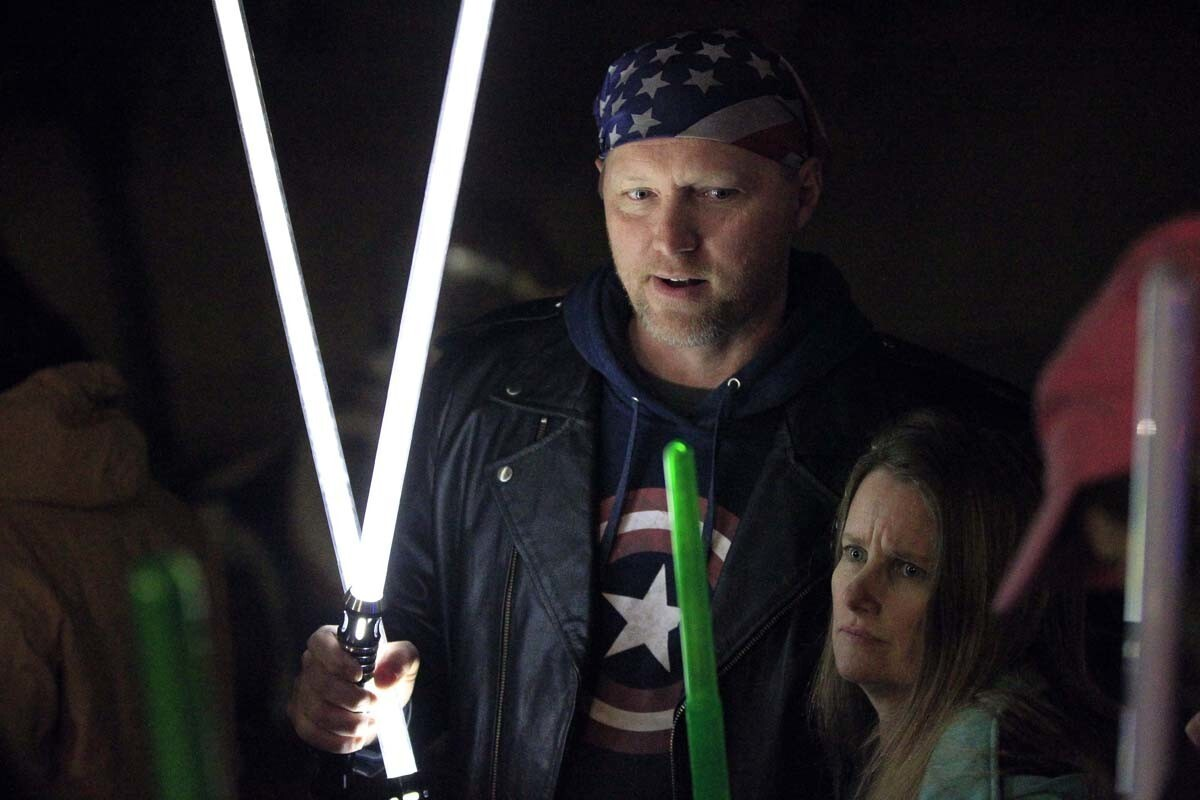 ESCONDIDO, December 30, 2016 | Shawn Richter holds two lightsabers as he and other Star Wars fans gather to pay tribute to actress Carrie Fisher at the California Center for the Arts in Escondido on Friday | Photo by Hayne Palmour IV/San Diego Union-Tribune/Mandatory Credit: HAYNE PALMOUR IV/SAN DIEGO UNION-TRIBUNE/ZUMA PRESS San Diego Union-Tribune Photo by Hayne Palmour IV copyright 2016