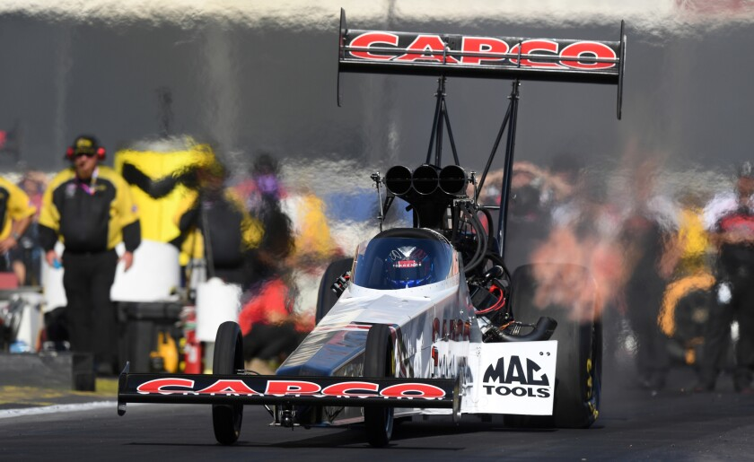 Steve Torrence moves his top-fuel dragster into position for a qualifying run at the Auto Club NHRA Finals.