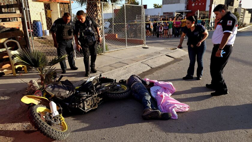 TIJUANA, BAJA CALIF. -- SATURDAY, JUNE 2, 2018: Tijuana Cruz Roja responds to the scene of a homicid
