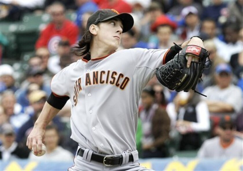 San Francisco Giants starting pitcher Tim Lincecum delivers during the first inning of a baseball game against the Chicago Cubs at Wrigley Field in Chicago, Tuesday, May 5, 2009. (AP Photo/Charles Rex Arbogast)