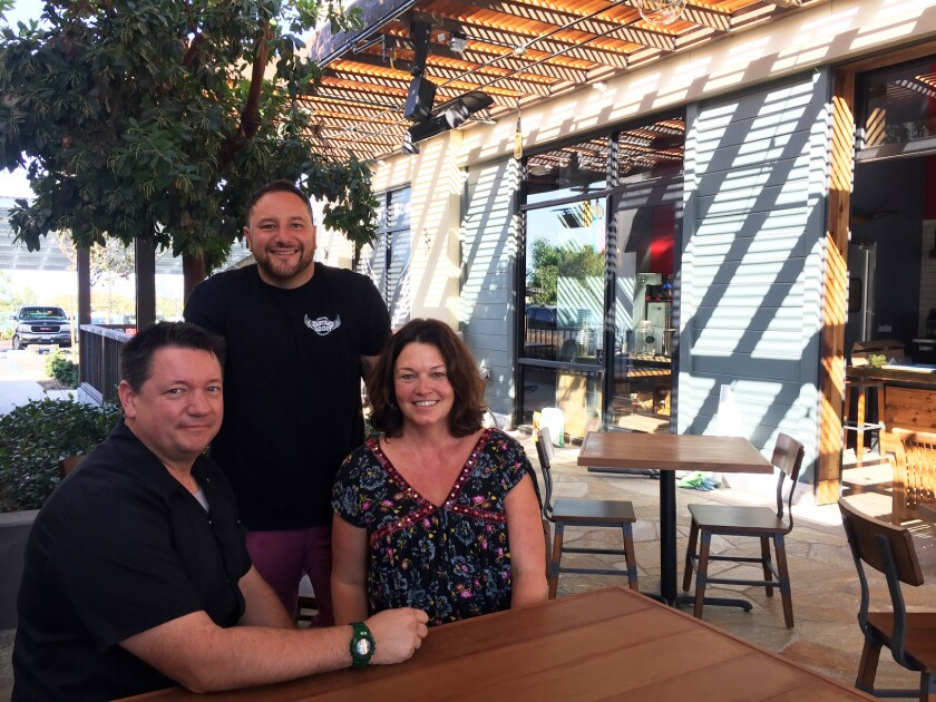 """Bantam's Roost Public House business partners Roger """"Roddy"""" Browning, left, Alex Kleinman and Aaron Browning on the new Carlsbad restaurant's covered patio."""
