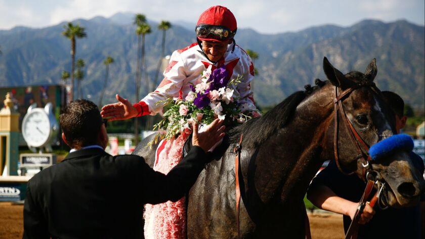 ARCADIA, CALIF. - APRIL 06: Jockey Mike Smith, riding Roadster (1) wins the Santa Anita Derby (Grade