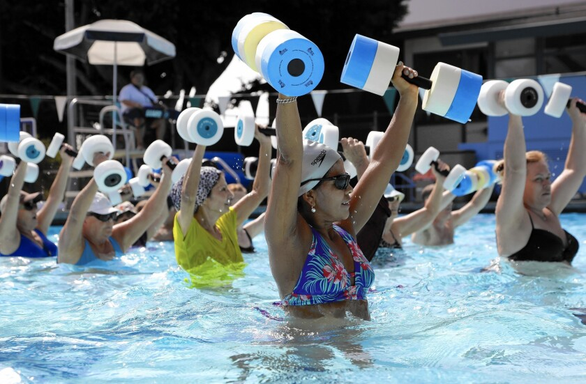 Maria Terrones, center foreground, participates in a water fitness class at the West Hollywood Pool.