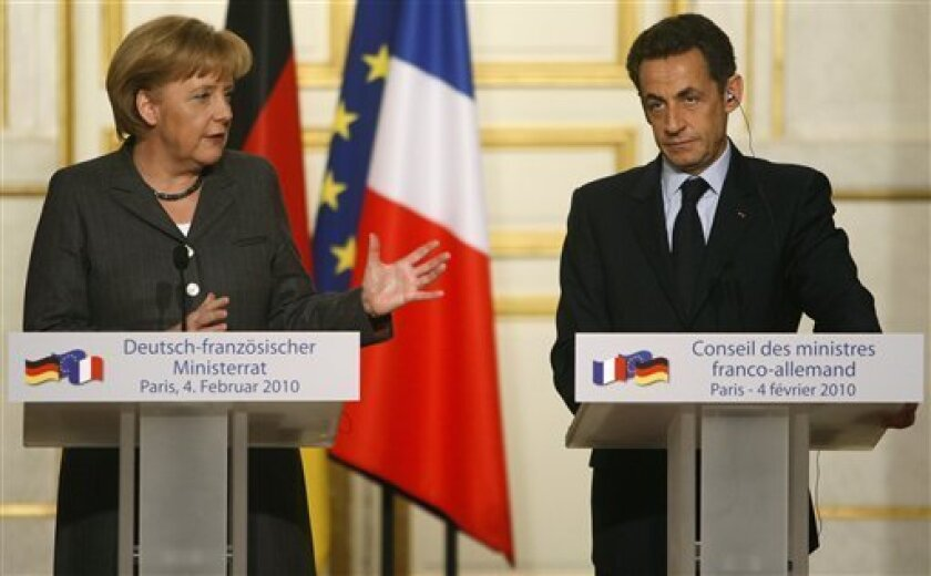 German Chancellor Angela Merkel, left, and France's President Nicolas Sarkozy, right, attend a joint press conference at the end of a French-German cabinet meeting, at the Elysee Palace in Paris, Thursday, Feb. 4, 2010. (AP Photo/Michel Euler)
