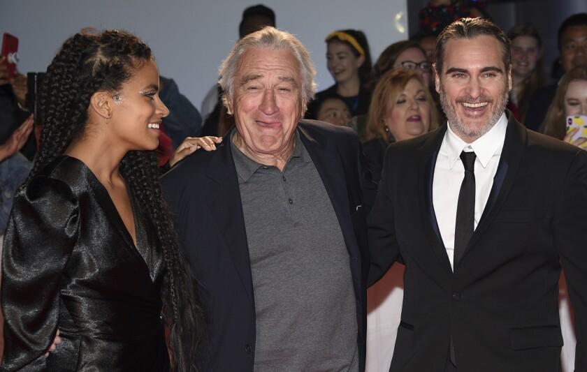 """Zazie Beetz, Robert De Niro and Joaquin Phoenix attend a premiere for """"Joker"""" on Sept. 9 at the Toronto International Film Festival."""