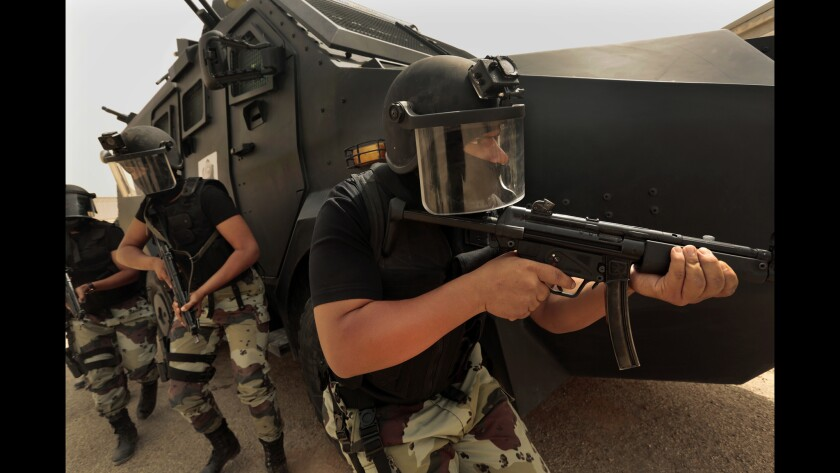Members of a SWAT team in Riyadh practice tactical maneuvers in preparation for possible terrorist attacks.
