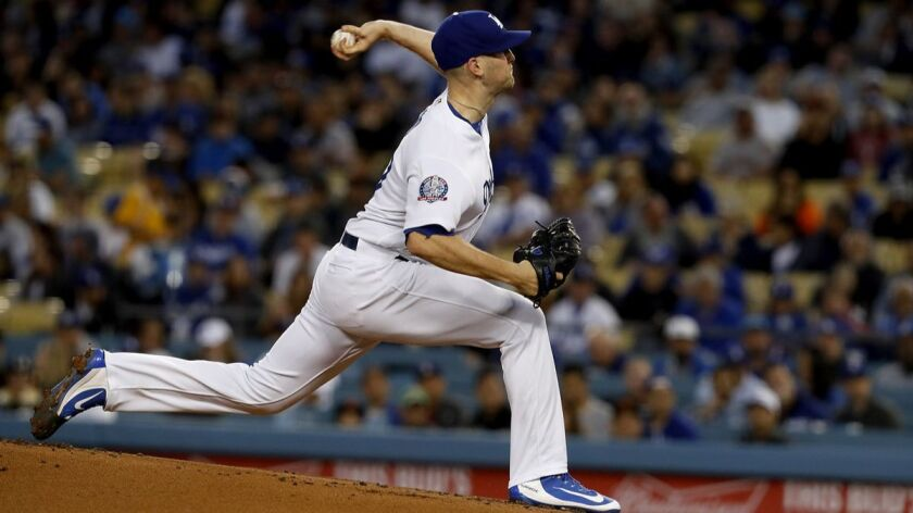 LOS ANGELES, CALIF. - MAR 30, 2018. Dodgers starter Alex Wood delivers a pitch against the Giants