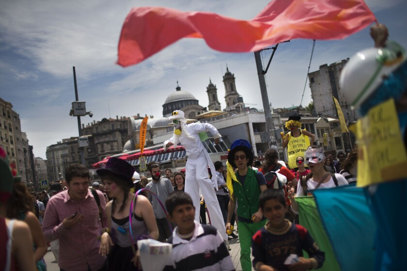 A Turkish art group performs in support of protesters at Taksim Square.