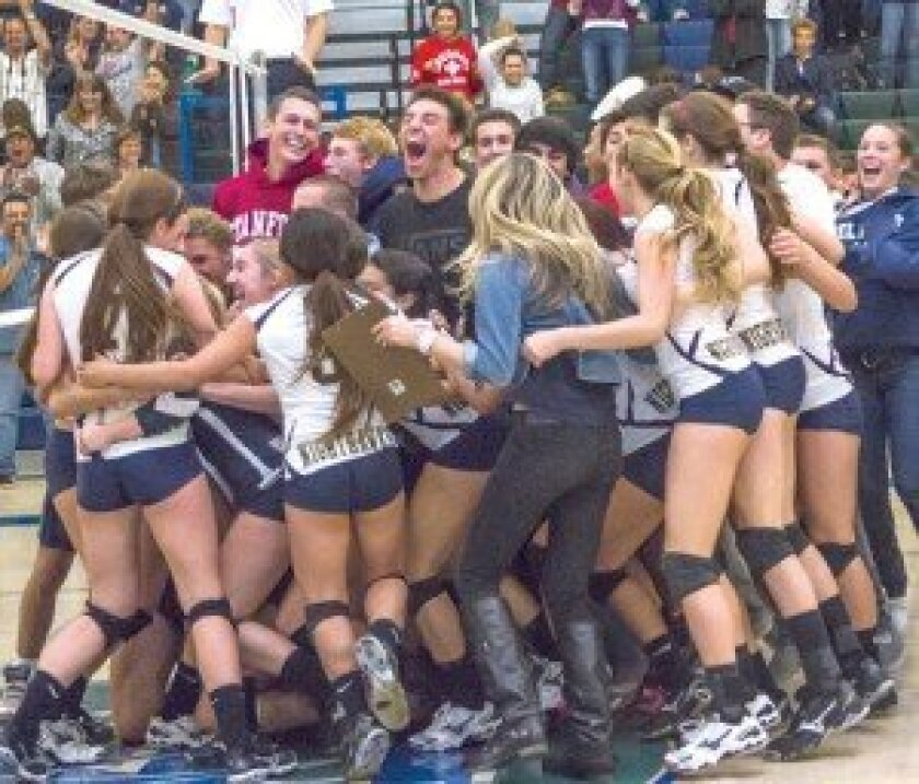 The Del Norte girls volleyball team celebrates with the crowd after earning a trip to the CIF San Diego Section Division III title match. File photo