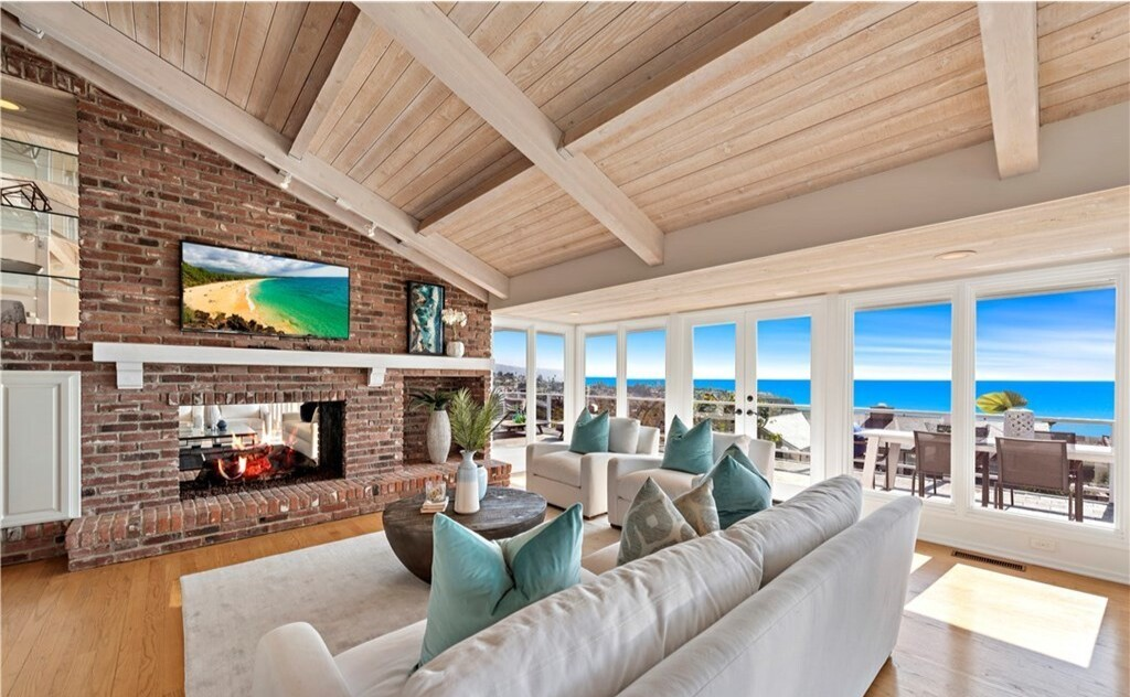 The two-story home takes in sweeping ocean views from a pair of spacious terraces.