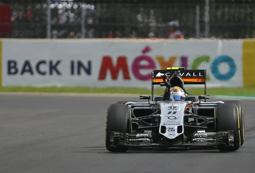 Force India driver Sergio Perez of Mexico waves to the fans as he drives during the third practice session for the Formula One Mexico Grand Prix auto race at the Hermanos Rodriguez racetrack in Mexico City, Saturday, Oct. 31, 2015. (AP Photo/Eduardo Verdugo)