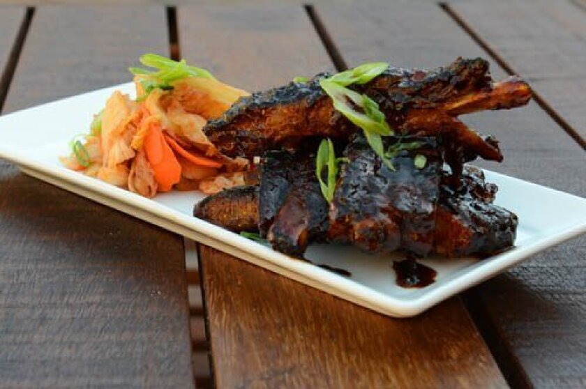 Grilled Baby Back Pork ribs are smothered in a Korean-style barbecue sauce. Photos by Kelley Carlson