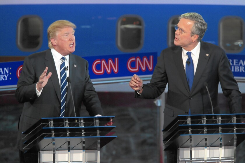 Republican presidential candidates Donald Trump and Jeb Bush spar in the GOP debate at the Reagan Presidential Library in September.