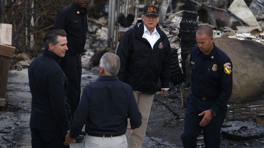MALIBU, CA ? NOVEMBER 17, 2018 - - President Donald Trump, center, surveys the damage from the Wool