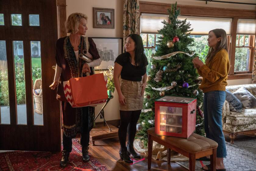 """Janet McTeer, from left, with Kelly Marie Tran and Elizabeth Olsen in a scene from """"Sorry for Your Loss."""""""