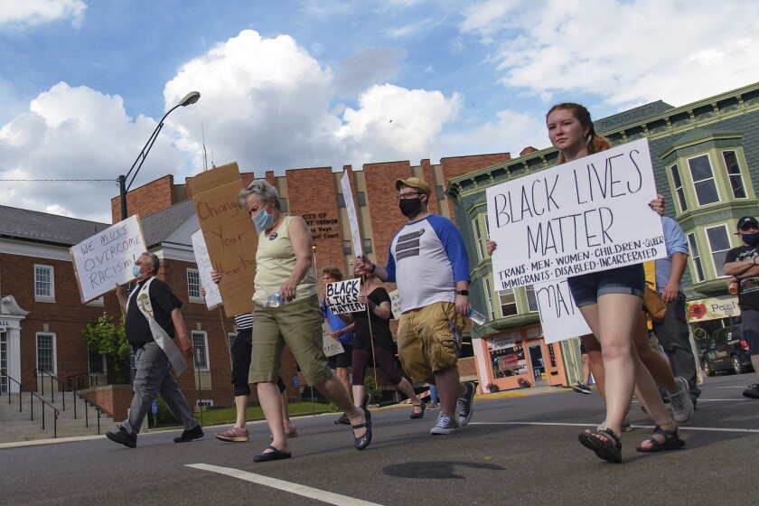 Protesters march past the Mount Vernon City Hall and Plaza Building on Tuesday, June 9, 2020, in Mount Vernon, Ohio, during a Justice for George Floyd event. (Joshua Morrison/Mount Vernon News via AP)