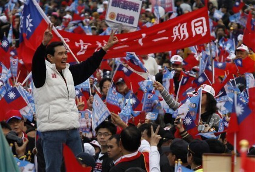 Taiwan's President and presidential candidate Ma Ying-jeou waves to supporters during an election campaign in Taipei, Taiwan, Sunday, Jan. 8, 2012. Taiwan will hold its presidential election on Jan. 14, 2012. (AP Photo/Vincent Yu)