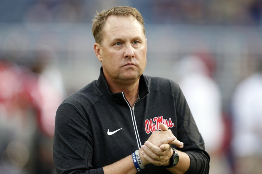 FILE - In this Oct. 24, 2015, file photo, Mississippi football coach Hugh Freeze watches his team warmup before an NCAA college football game against Texas A&M in Oxford, Miss. Speaking at the Southeastern Conference's annual meetings Tuesday, May 31, 2016, Freeze delivered a lengthy, prepared stat