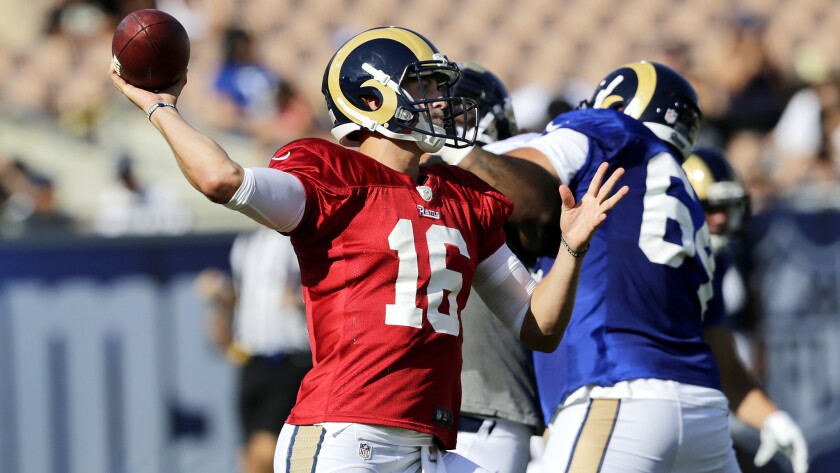 Rams quarterback Jared Goff takes aim at a receiver during a team scrimmage Saturday at the Coliseum.