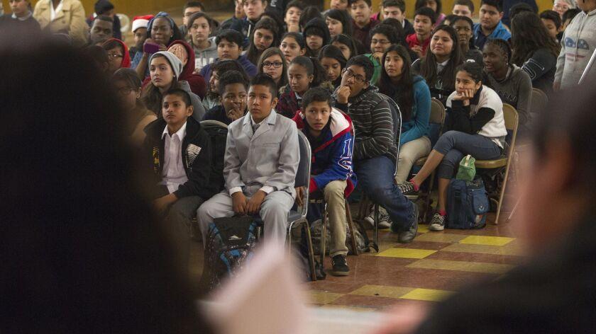 LOS ANGELES, CA - DECEMBER 18, 2014: Members of the student body listen as eighth grade debate teams
