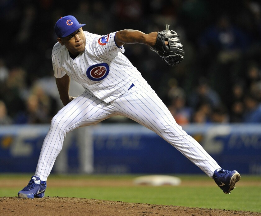 Carlos Marmol delivers a pitch against the Colorado Rockies on May 13.