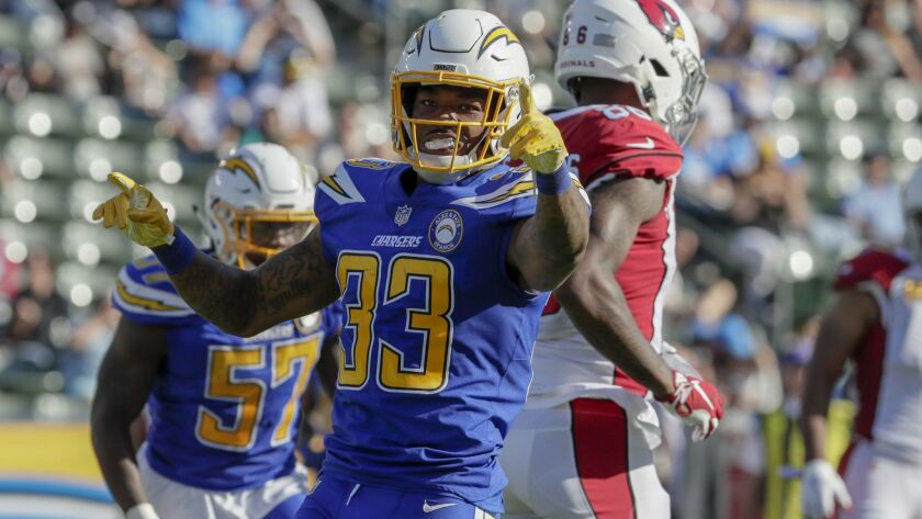 Chargers safety Derwin James celebrates after making a tackle against the Arizona Cardinals in November.