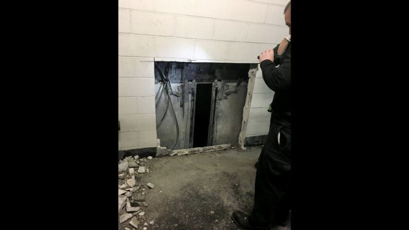 Firefighters rescued six people by cutting through this brick wall on the 11th floor of the building formerly known as the John Hancock Center early on Nov. 16, 2018.