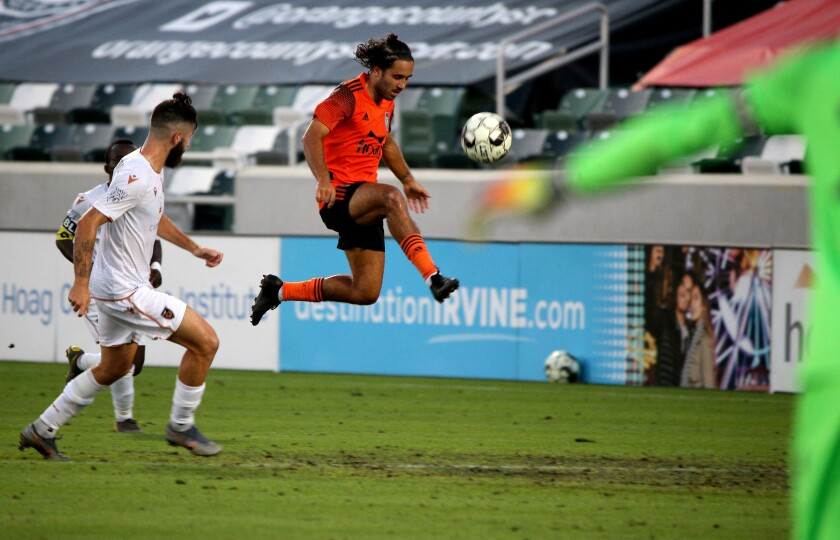 Orange County Soccer Club midfielder Seth Casiple tries to control the ball.