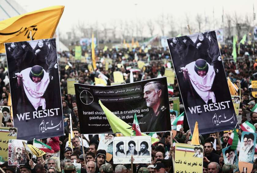 Iranian demonstrators hold a portrait of Iranian commander Major Gen. Qassem Suleimani, who has been advising Iraqi military leaders fighting Islamic jihadists, during a rally to mark the 36th anniversary of the Islamic revolution in Tehran's Freedom Square on Feb. 11.