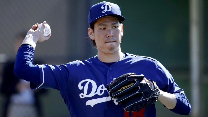 Dodgers rookie Kenta Maeda throws during a spring training baseball workout Feb. 20.
