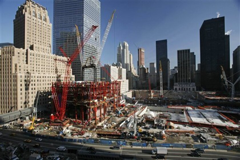 In this file photo of Dec. 18, 2009, construction cranes work over the rising steel frame, left, of 1 World Trade Center, in New York. The building that is also known as the Freedom Tower has reached the equivalent of the 20th floor. The planned 104-story skyscraper is scheduled to be completed in 2013. It will be 1,776-feet from street level to the top of the tower's antenna. (AP Photo/Mark Lennihan, file)