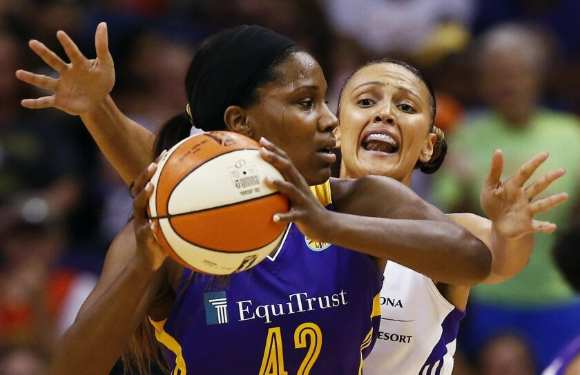 Phoenix Mercury's Mistie Bass pressures Los Angeles Sparks' Jantel Lavender during a WNBA basketball game Friday, Aug. 21, 2015, in Phoenix. (Rob Schumacher/The Arizona Republic via AP) MARICOPA COUNTY OUT; MAGS OUT; NO SALES; MANDATORY CREDIT