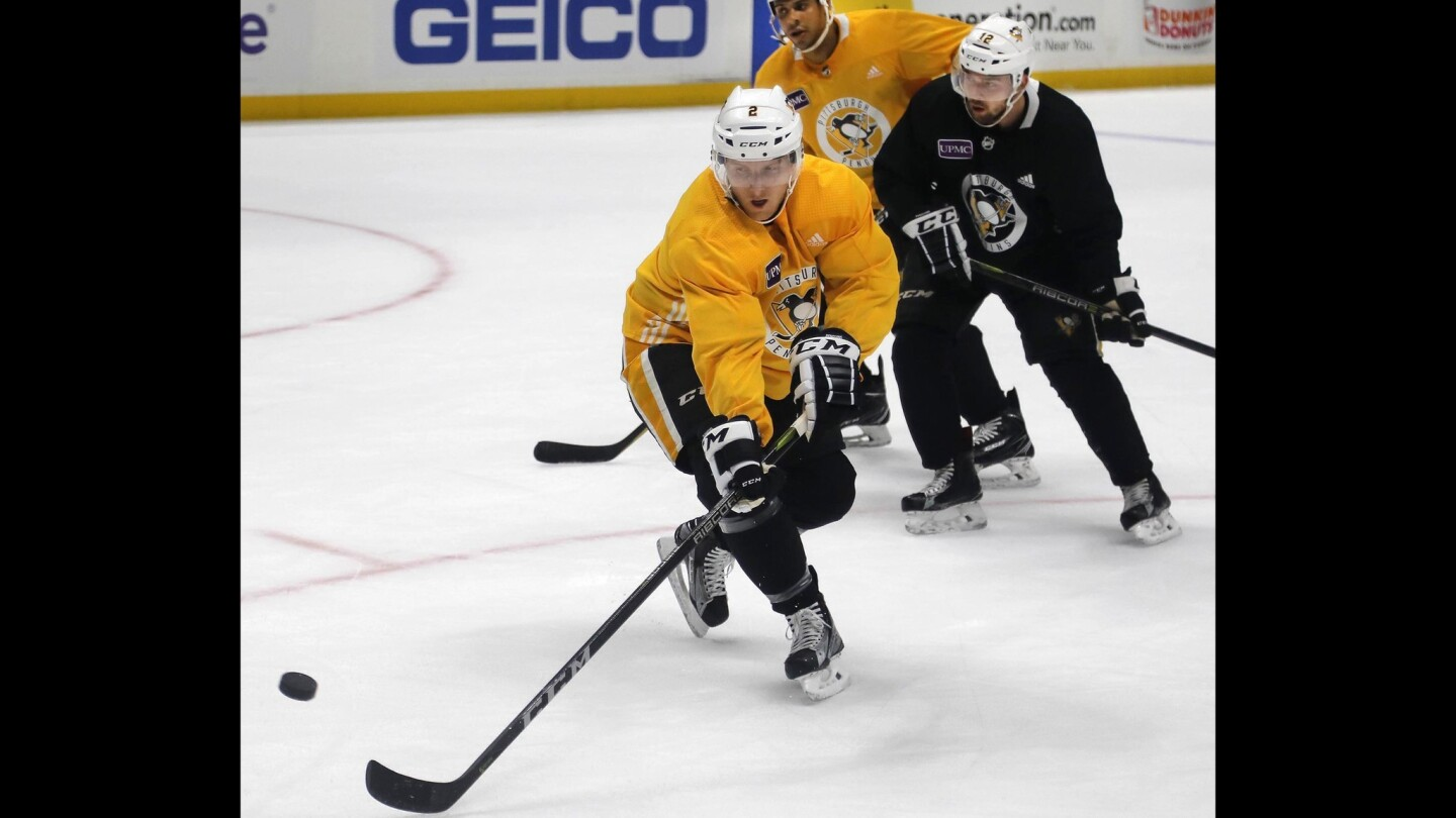 Pittsburgh Penguins Hockey defenseman, Chad Ruhwedel, who grew up in San Diego, foreground, along with other members of the team, practice at the Honda Center in Anaheim in preparation for their game Wednesday night against the Anaheim Ducks.