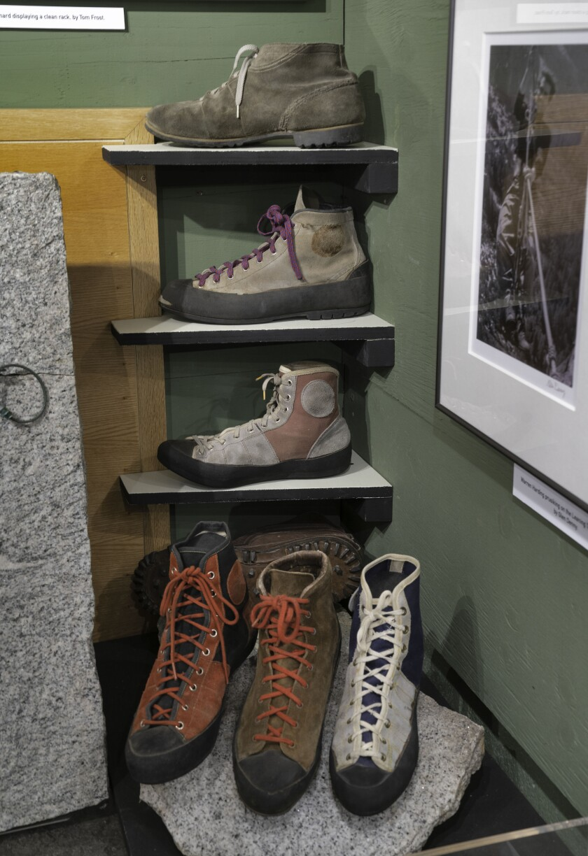 Old climbing boots on shelves