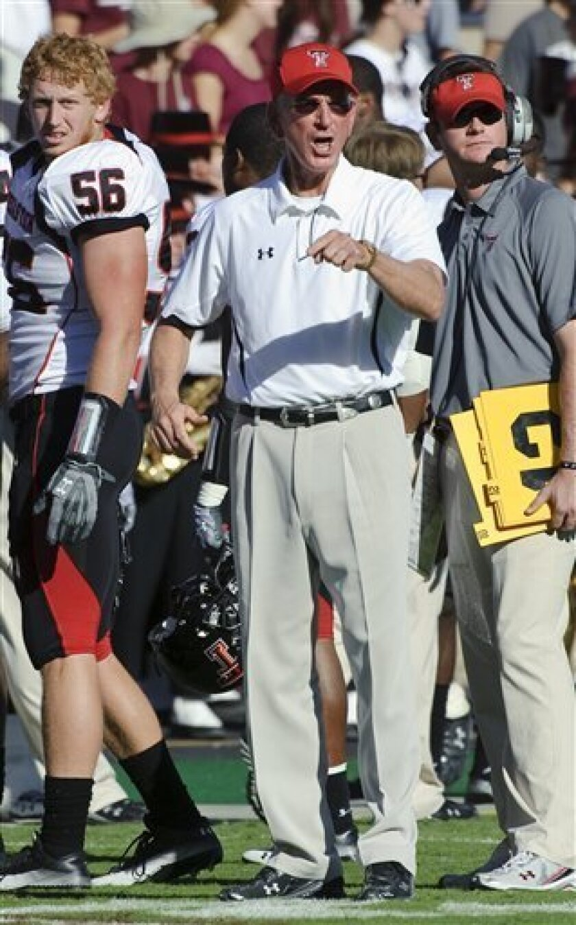 Texas Tech head coach Tommy Tuberville, center, reacts to a call during the second quarter of an NCAA college football game against Texas A&M, Saturday, Oct. 30, 2010, in College Station, Texas. (AP Photo/Dave Einsel)