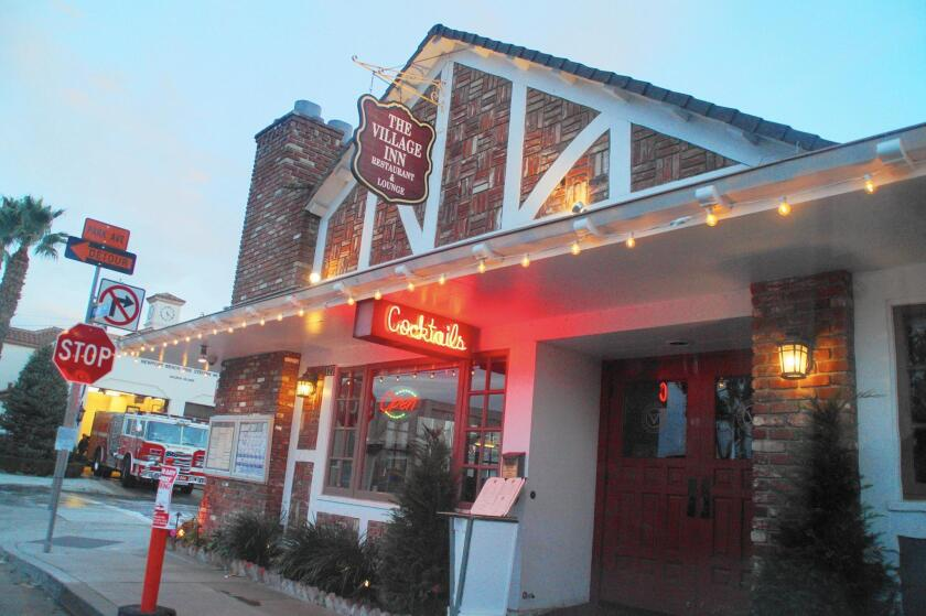 The Newport Beach City Council gave preliminary approval Tuesday for the Village Inn restaurant on Balboa Island to have an outdoor patio on a portion of the sidewalk on its Park Avenue side, pictured. Another part was approved for the sidewalk on the Marine Avenue side.